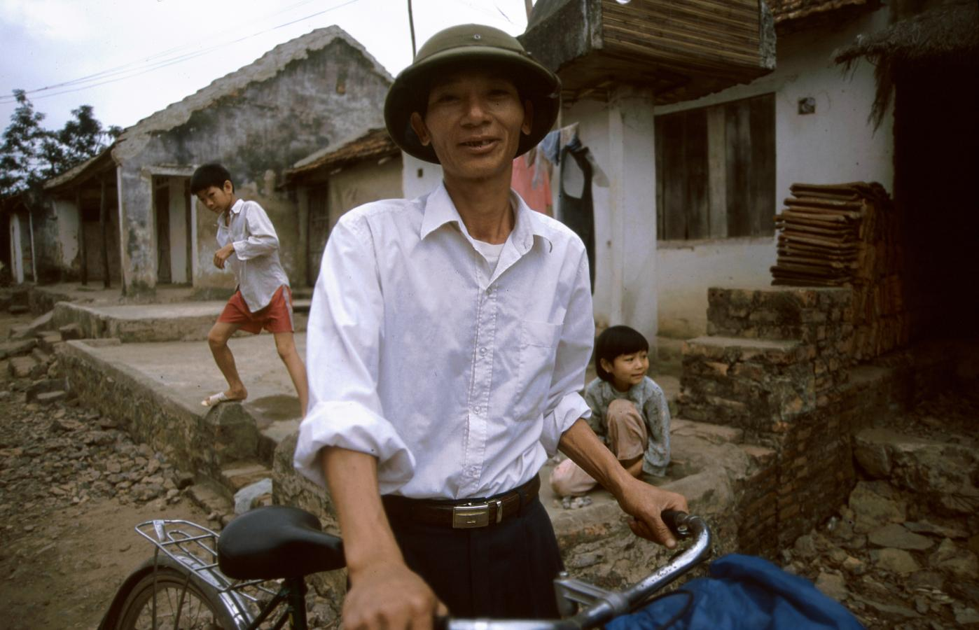 man-with-bicycle-small-village-around-hanoi-vietnam-2002