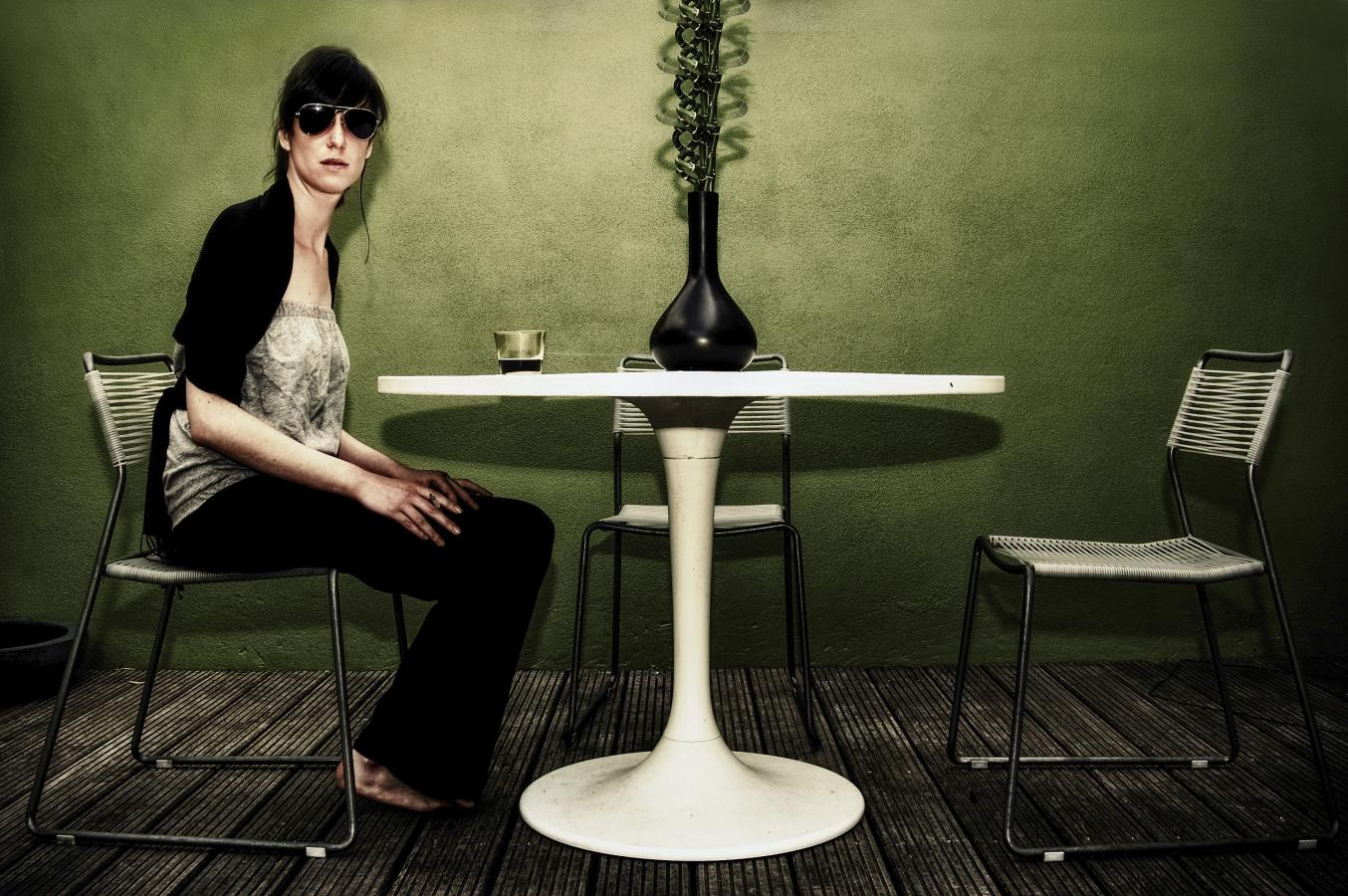 white-table-green-wall-rayban-and-a-coke